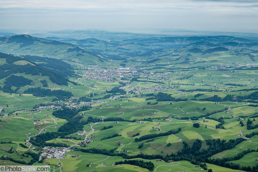 Starting a lower left, see Brülisau, Weissbad, Schwende, Steinegg and Appenzell villages, from high atop Hoher Kasten mountain in the Alpstein limestone range, Appenzell Alps, Switzerland, Europe. Hoher Kasten (1795 m) is on the border between the cantons of Appenzell Innerrhoden and St. Gallen. Appenzell Innerrhoden is Switzerland's most traditional and smallest-population canton (second smallest by area).