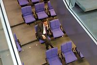 13 FEB 2003, BERLIN/GERMANY:<br /> Gerhard Schroeder, SPD, Bundeskanzler, sitzt allein in den hinteren Reihen der SPD Bundestagsfraktion, Bundestagsdebatte zur Regierungserklaerung des BK zur aktuellen internationalen Lage, Plenum, Deutscher Bundestag <br /> IMAGE: 20030213-01-085<br /> KEYWORDS: Gerhard Schröder