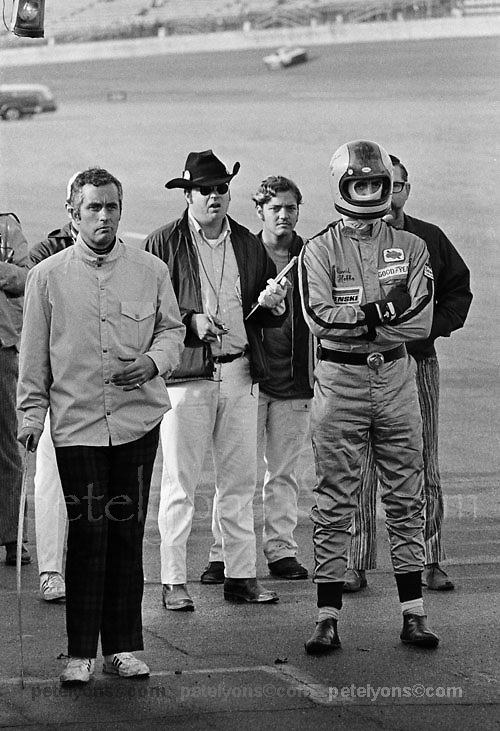 Roger Penske, left, with his driver David Hobbs wait for Mark Donohue to pit with their Ferrari 512M during the 1971 Daytona 24 race; Photo by Pete Lyons 1971/ © Pete Lyons / petelyons.com;