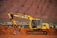 Tractors help clear land for home building expansion Ivins, near St. George, UTAH