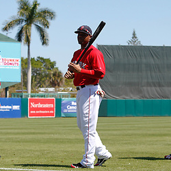 March 7, 2011; Fort Myers, FL, USA; Boston Red Sox third baseman Kevin Youkilis (left) left fielder Carl Crawford (center) and first baseman David Ortiz before a spring training exhibition game against the Baltimore Orioles at City of Palms Park.   Mandatory Credit: Derick E. Hingle