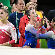 United States gymnast Alexandra Raisman laughed with teammate Simone Biles, right, after Biles won gold and Raisman won silver in Tuesday's women's individual floor exercise at the Rio Olympic Arena during the 2016 Summer Olympics Games in Rio de Janeiro, Brazil. At left is Switerland's Giulia Steingruber, who finished in eighth place.