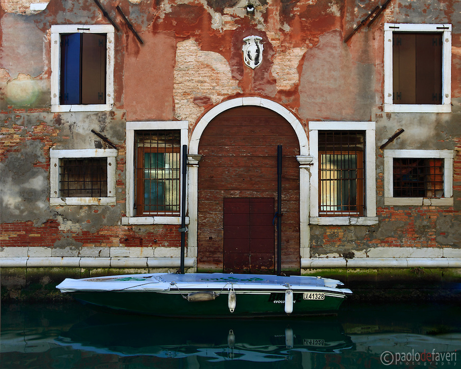 A fine example of bizarre Venetian archtecture. I suppose those windows were probably open in various centuries, for various reasons. A canal in Cannaregio in Venice, Italy