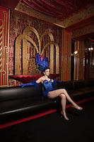 Showgirl sitting on couch