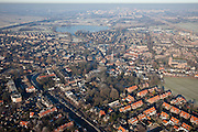 Nederland, Noord-Holland, Abcoude, 10-01-2009; overzicht dorpskern met bevroren riviertje de Angstel, in de achtergrond Abcoudermeer en Amsterdam-Zuidoost; overview village center with the frozen river Angstel; villadorp, yup, yuppie, ijs, ice;  .luchtfoto (toeslag); aerial photo (additional fee required); .foto Siebe Swart / photo Siebe Swart