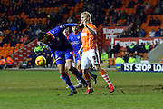 Oldham Athletic Midfielder, Timothe Dieng and Blackpool Striker Mark Cullen battle during the Sky Bet League 1 match between Blackpool and Oldham Athletic at Bloomfield Road, Blackpool, England on 16 February 2016. Photo by Pete Burns.