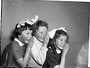 22/05/1959<br /> 05/22/1959<br /> 22 May 1959<br /> Gael Linn Singing Competition at the Dominican Convent, Dun Laoghaire. (l-r) ~Maire Treasa Ní Broin; Poilin Ní Gallchobhair and Antoine Ní Dhonnachair all from Scoil Haroid Glasthule, who recited poems at the concert.