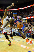Feb 4, 2010; Cleveland, OH, USA; Cleveland Cavaliers forward LeBron James (23) drives around Miami Heat forward Dorell Wright (1) during the first quarter at Quicken Loans Arena. Mandatory Credit: Jason Miller-US PRESSWIRE