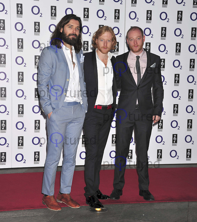 Simon Neil, James Johnston and Ben Johnston of Biffy Clyro Nordoff Robbins O2 Silver Clef Awards, annual fundraiser, recognising outstanding musical talent, London Hilton, Park Lane, London, UK, 01 July 2011:  Contact: Rich@Piqtured.com +44(0)7941 079620 (Picture by Alan Roxborough)