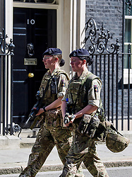 © Licensed to London News Pictures. 25/05/2017. London, UK. Armed soldiers walk past 10 Downing Street in Westminster, London following a terrorist attack in Manchester, northern England, earlier this week. 23 people were killed an dozens more injured when Salman Abedi set off a suicide bomb at an Ariana Grande concert.  Photo credit: Ben Cawthra/LNP