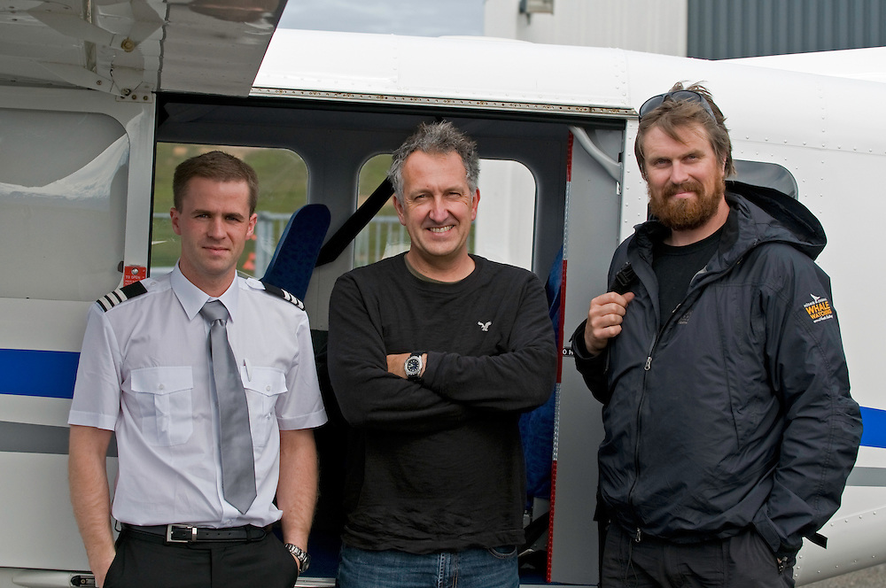 Steindor Kristinn Jonsson (pilot), Mark Carwardine (photographer) and Heimir Hardarson (whale spotter) with plane used for Wild Wonders of Europe mission, Husavik, northern Iceland