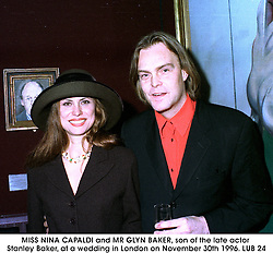 MISS NINA CAPALDI and MR GLYN BAKER, son of the late actor Stanley Baker, at a wedding in London on November 30th 1996.LUB 24