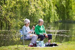 © Licensed to London News Pictures. 17/05/2016. Leeds UK. Two ladies have lunch in Temple Newsam park in Leeds as Yorkshire see's another fine weather day. Photo credit: Andrew McCaren/LNP