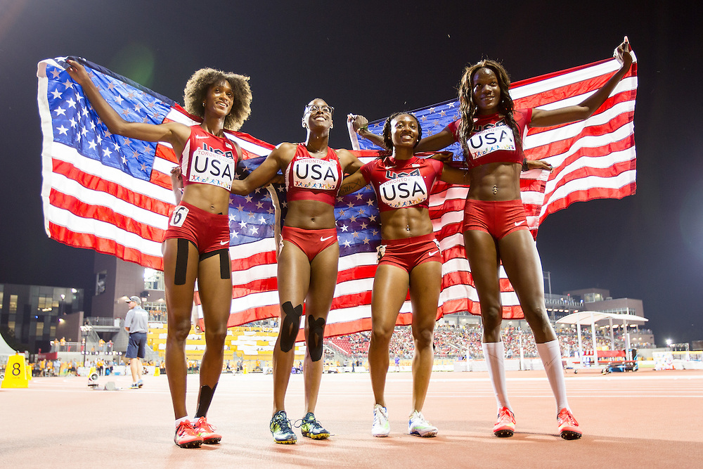 The American 4X400 metre team of (L-R)  Kendall Baisden, Shamier Little, Kyra Jefferson and Shakima Wimbley celebrate their gold medal win at the 2015 Pan American Games at CIBC Athletics Stadium in Toronto, Canada, July 25,  2015.  AFP PHOTO/GEOFF ROBINS
