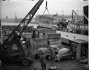 08/12/1959<br /> 12/08/1959<br /> 08 December 1959<br /> Loading Heinkel cars onto a ship at Sir John Rogerson's Quay, Dublin for Lincoln and Nolan. Crates are marked for Argentina. Crane is marked B. & I. Line.