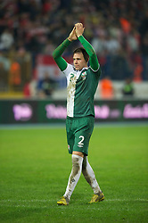 OSIJEK, CROATIA - Tuesday, October 16, 2012: Wales' Chris Gunter applauds the travelling supporters after his side's 2-0 defeat by Croatia during the Brazil 2014 FIFA World Cup Qualifying Group A match at the Stadion Gradski Vrt. (Pic by David Rawcliffe/Propaganda)