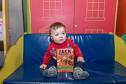 The most popular baby names in Scotland have been announced at Leith Library in Edinburgh. The most names for 2018 are unchanged from 2017 with Jack and Olivia taking the top spots.<br /> <br /> Pictured:8 month old Gregor Mann holding a book titled with the most popular boys name, Jack