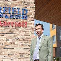 070115      Cayla Nimmo<br /> <br /> Terry Bruner, director of New Mexico USDA, poses outside of the Fairfield Inn and Suites in Gallup before the grand opening Wednesday.