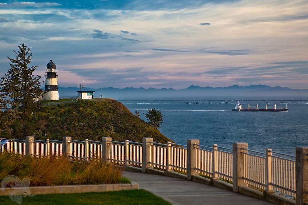 The Cape Disappointment lighthouse shines over the Columbia River bar entrance to the Pacific Ocean.