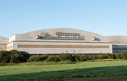 © Licensed to London News Pictures. 29/07/2019; Bristol, UK. The central bay of the Brabazon hanger at Filton Airfield. Malaysian company YTL Developments are proposing to build a new 16,000 seater 'Bristol Arena' for concerts and events in the Brabazon hangers, and Filton Airfield is to be redeveloped for housing by YTL. The new Brabazon neighbourhood will eventually have thousands of new homes, schools, health centre, university campus and employment space. After the Second World War, the concrete runway at Filton Aerodrome was extended to enable the huge Bristol Brabazon airliner to take off safely. The three-bay Brabazon Hangar was built in the late 1940s and the hangar doors were the largest in the world at the time. After a worker was crushed and killed while taking a sleep in one of the folds of the hangar doors, a siren was installed to warn employees when the doors were being operated. Photo credit: Simon Chapman/LNP.