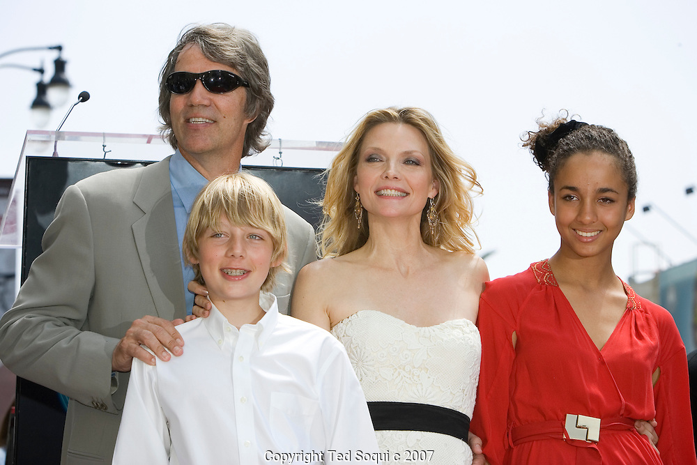 "Michelle with her husband and two children..Michelle Pfeiffer honored with star on the Hollywood Walk Of Fame. This was the 2,345 Star on the Hollywood Walk Of Fame. .Michelle starred in ""Scarface"", ""Love Field"", ""The Fabulous Baker Boys"", and Frankie and Johnny."" .Jeff Bridges and Paul Rudd were also there to honor her..Hollywood and Highland Complex, Hollywood, CA"