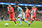 Manchester City midfielder Raheem Sterling on the attack watched by Sevilla  defender Adil Rami during the Champions League Group D match between Manchester City and Sevilla at the Etihad Stadium, Manchester, England on 21 October 2015. Photo by Alan Franklin.