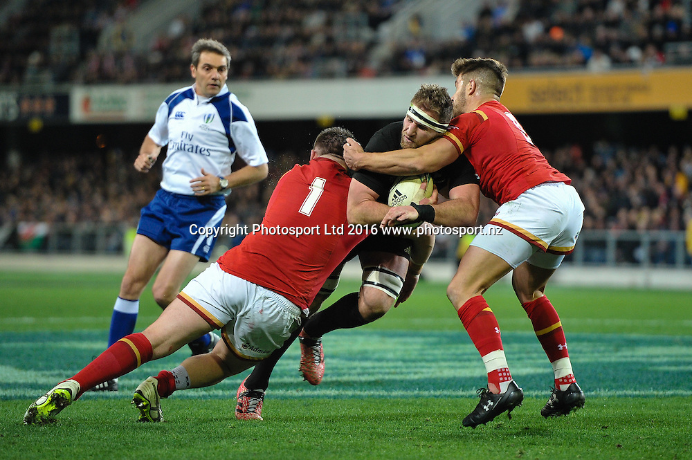 Kieran Read of the All Blacks off loads in the tackle of Rob Evans of Wales and Rhys Webb of Wales during the 3rd Steinlager Series Rugby Union Test match, All Blacks v Wales, at Forsyth Barr Stadium, Dunedin, New Zealand. 25th June 2016. Copyright Photo: John Davidson / www.photosport.nz