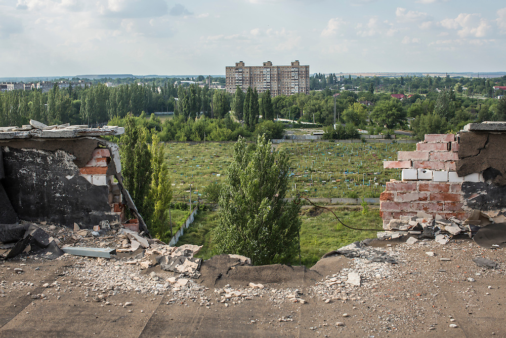 AVDIIVKA, UKRAINE - JULY 9, 2016: The months-old remnant of artillery that hit the roof of a residential building near the front lines in Avdiivka, Ukraine. The town is now one of the most active areas of fighting along the line of control between the Ukrainian government and Russian-backed rebels. CREDIT: Brendan Hoffman for The New York Times