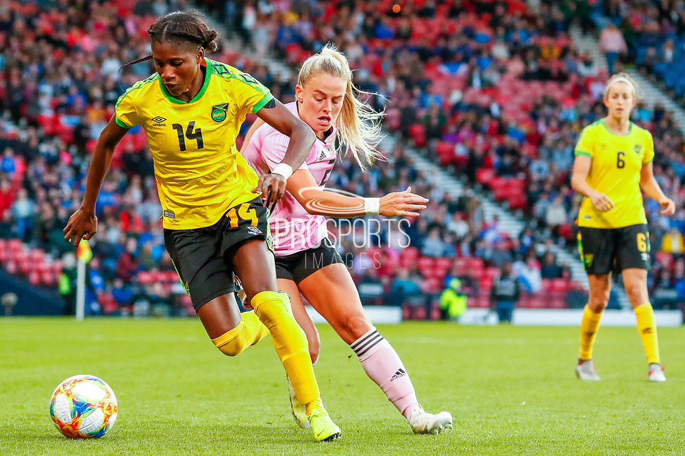 Deniesha BLACKWOOD (Univ. West Florida (USA)) of Jamiaca shields the ball from Scotlands Kirsty SMITH (Manchester United WFC (ENG)) during the International Friendly match between Scotland Women and Jamaica Women at Hampden Park, Glasgow, United Kingdom on 28 May 2019.