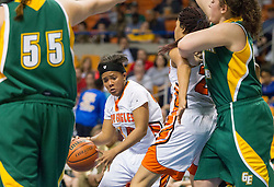 South Charleston guard Shy'Anne Dunham (24) drives into the lane against Greenbrier East during a first round game at the Charleston Civic Center.