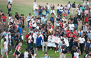CAPE TOWN, SOUTH AFRICA - Thursday 9 April 2015, students arrive during the removal of the statue of CECIL JOHN RHODES at the University of Cape Town. Rhodes (5 July 1853 &ndash; 26 March 1902) was a British businessman, mining magnate, and politician in South Africa. An ardent believer in British colonialism, Rhodes was the founder of the southern African territory of Rhodesia, which was named after him in 1895. South Africa's Rhodes University is also named after Rhodes. He set up the provisions of the Rhodes Scholarship, which is funded by his estate. <br /> Photo by Roger Sedres/ ImageSA