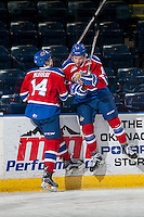 KELOWNA, CANADA - FEBRUARY 22: Davis Murray #14 and Kobe Mohr #18 of the Edmonton Oil Kings have a little fun at the boards during warm up against the Kelowna Rockets on February 22, 2017 at Prospera Place in Kelowna, British Columbia, Canada.  (Photo by Marissa Baecker/Shoot the Breeze)  *** Local Caption ***