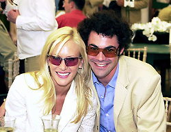 The HON.LUCAS and MRS WHITE, she was model Normandie Keith, at a polo match in Berkshire on 30th July 2000.OGN 206