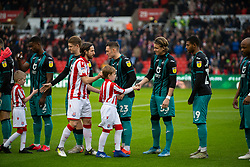 STOKE-ON-TRENT, ENGLAND - Saturday, January 25, 2020: Stoke City's captain Joe Allen shakes hands with his international Wales team-mate Swansea City's Connor Roberts before the Football League Championship match between Stoke City FC and Swansea City FC at the Britannia Stadium. (Pic by David Rawcliffe/Propaganda)