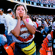 World Series fans react moments after the 1989 Loma Prieta earthquake magnitude of 6.9 hit and the shock was responsible for 63 deaths and 3,757 injuries in the affected areas.