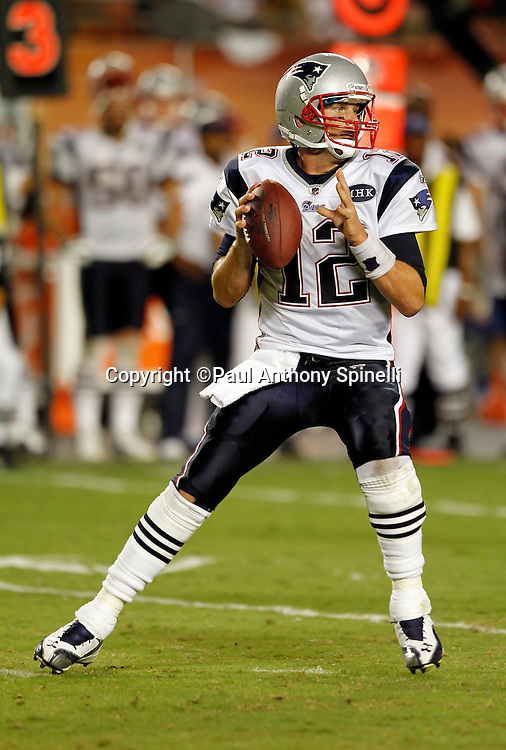 New England Patriots quarterback Tom Brady (12) drops back to pass during the NFL week 1 football game against the Miami Dolphins on Monday, September 12, 2011 in Miami Gardens, Florida. The Patriots won the game 38-24. ©Paul Anthony Spinelli