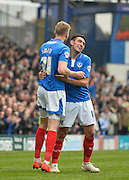 Portsmouth forward Michael Smith and Portsmouth midfielder Gary Roberts celebrate Portsmouth forward Michael Smith goal to make it 1-0 during the Sky Bet League 2 match between Portsmouth and Carlisle United at Fratton Park, Portsmouth, England on 2 April 2016. Photo by Adam Rivers.