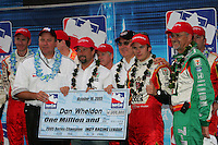 Brian Barnhardt presents Michael Andretti, Kevin Savore, Dan Wheldon and Kim Green with champions check at the California Speedway, Toyota Indy 400, October 16, 2005