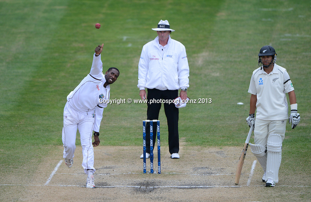 Shane Shillingford bowling on Day 5 of the 1st cricket test match of the ANZ Test Series. New Zealand Black Caps v West Indies at University Oval in Dunedin. Saturday 7 December 2013. Photo: Andrew Cornaga/www.Photosport.co.nz