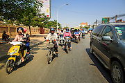 30 JANUARY 2013 - PHNOM PENH, CAMBODIA:   Motorcycles in traffic in Phnom Penh, Cambodia.    PHOTO BY JACK KURTZ