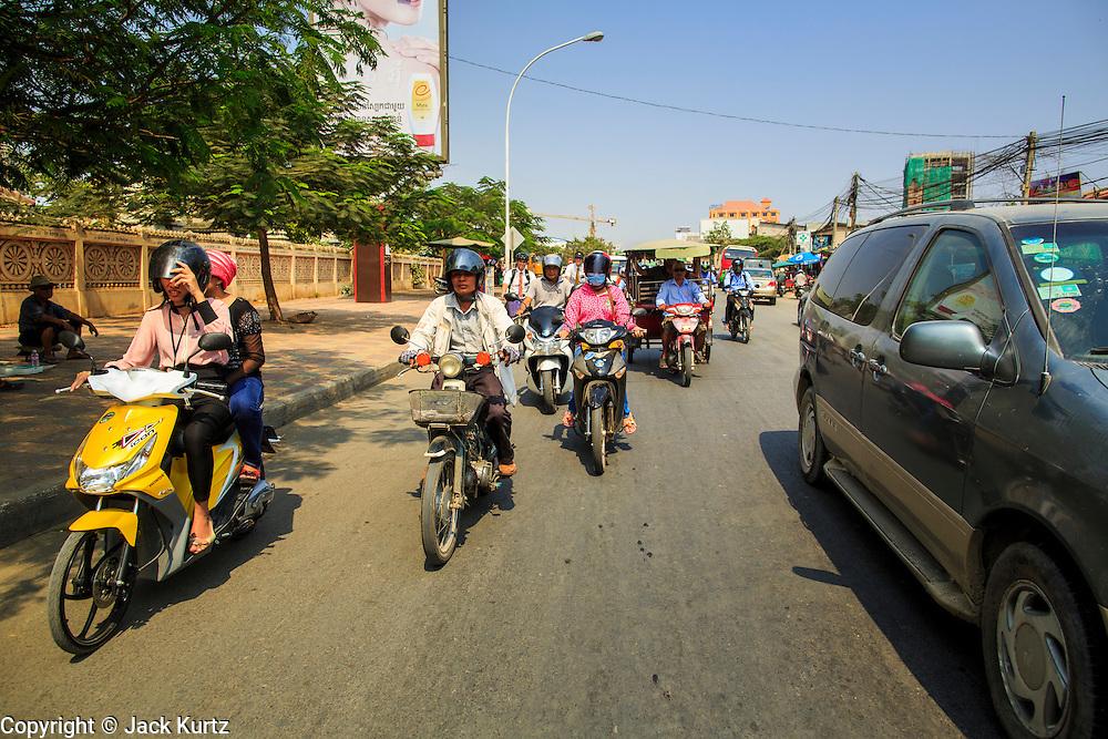 30 JANUARY 2013 - PHNOM PENH, CAMBODIA:   Motorcycles in traffic in Phnom Penh, Cambodia.    PHOTO BY JACK KURTZ