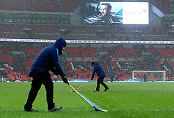 Ground staff clear the snow off The Wembley pitch at half time during Tottenham Hotspur v Rochdale in The FA Cup - Mandatory by-line: Robbie Stephenson/JMP - 28/02/2018 - FOOTBALL - Wembley Stadium - London, England - Tottenham Hotspur v Rochdale - Emirates FA Cup fifth round proper
