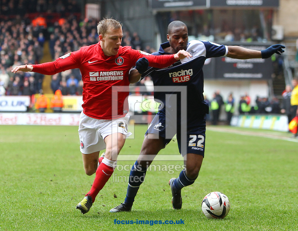 Picture by John  Rainford/Focus Images Ltd +44 7506 538356.16/03/2013.Chris Solly of Charlton Athletic is held off by Dany N'Guessan of Millwall during the npower Championship match at The Valley, London.
