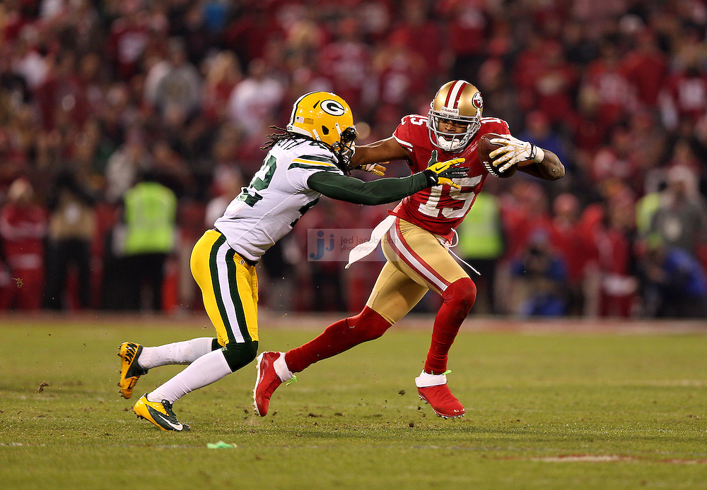 San Francisco 49ers wide receiver Michael Crabtree (15) catches a pass against Green Bay Packers strong safety Morgan Burnett (42) during a NFL Divisional playoff game at Candlestick Park in San Francisco, Calif., on Jan. 12, 2013. The 49ers defeated the Packers 45-31. (AP Photo/Jed Jacobsohn)