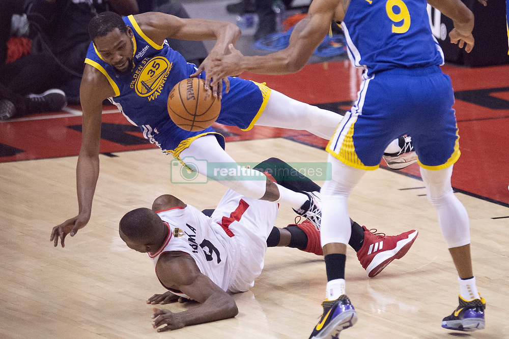 June 11, 2019 - Toronto, on, Canada - Golden State Warriors forward Kevin Durant (35) draws a loose ball foul on Toronto Raptors centre Serge Ibaka (9) during first half basketball action in Game 5 of the NBA Finals in Toronto on Monday, June 10, 2019. (Credit Image: © Chris Young/The Canadian Press via ZUMA Press)