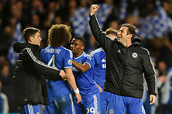 Chelsea Defender John Terry (ENG) punches the air as his side celebrates at the final whistle after a dramatic 2-0 win to progress to the semi-final - Photo mandatory by-line: Rogan Thomson/JMP - 07966 386802 - 08/04/2014 - SPORT - FOOTBALL - Stamford Bridge, London - Chelsea v Paris Saint-Germain - UEFA Champions League Quarter-Final Second Leg.