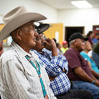Anderson Mariano listens to Jonathan Nez speak during a meet and greet event Sunday Sept. 30, 2018 at the Chichiltah chapter house.