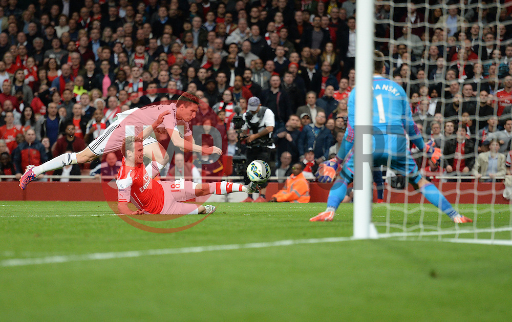 Arsenal's Nacho Monreal shoots but his shot is saved by Swansea City's Lukasz Fabianski - Photo mandatory by-line: Alex James/JMP - Mobile: 07966 386802 - 11/05/2015 - SPORT - Football - London - Emirates Stadium - Arsenal v Swansea City - Barclays Premier League