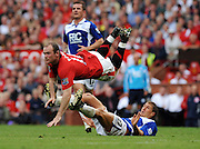 Wayne Rooney of Manchester United is tackled by Gregory Vignal of Birmingham City during the Barclays Premier League match between Manchester United and Birmingham City at Old Trafford on August 16, 2009 in Manchester, England.