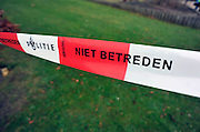 Nederland, Malden, 1-12-2011De plaats waar de politie onderzoek goet naar een misdrijf is afgezet met rood-wit geblokt lint.Foto: Flip Franssen/Hollandse Hoogte